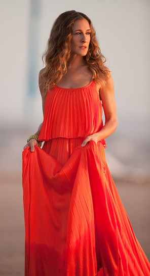sarah jessica parker in halston orange pleated dress